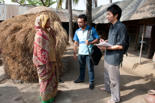 Daigo Ishiyama (right), an industrial designer with American Standard Brands, interviews a villager in Bangladesh, along with a representative from the International Development Enterprises (iDE).